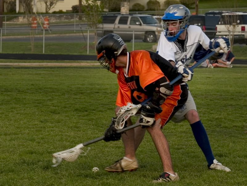 Evan Alexander (attack, sophomore) boxes out a defender on a groundball.