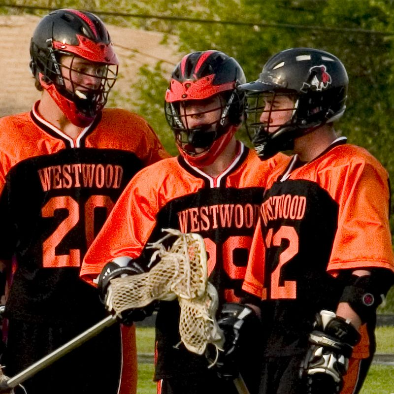 Midfielders Brendan Murphy, Alex Ierullo, and Will Anderson discuss a play during a break in the game.