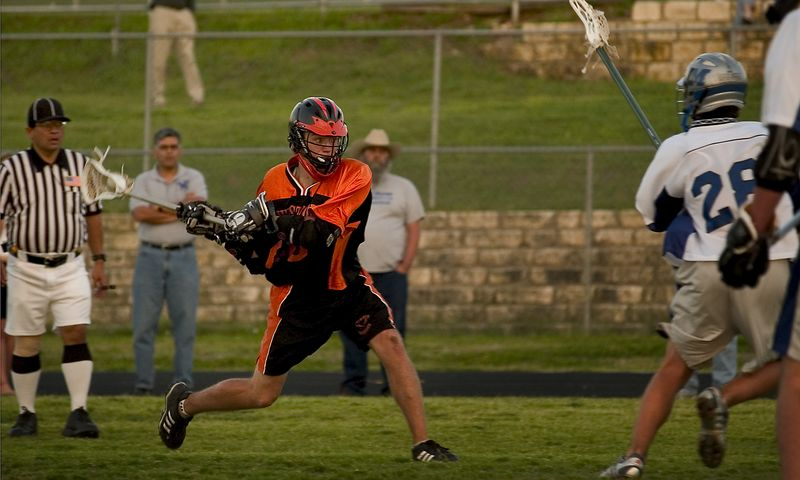 Brendan Murphy (midfield) cranks up for a shot on a man-up play.