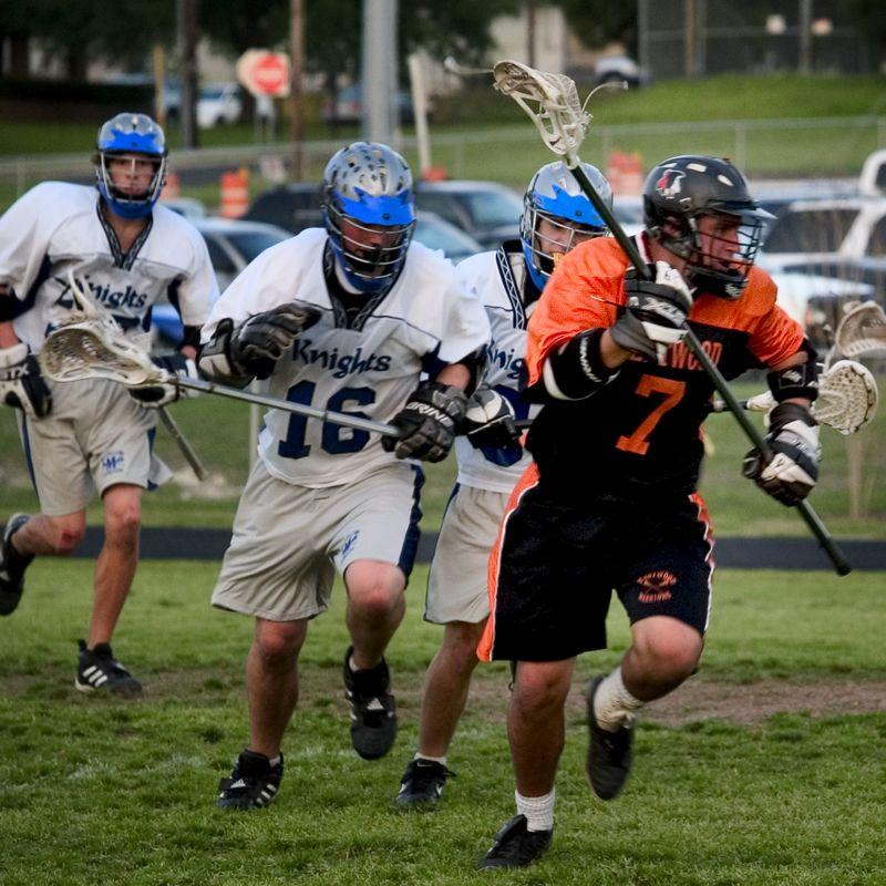 Gavin Rogus (senior defense) moves the ball upfield.