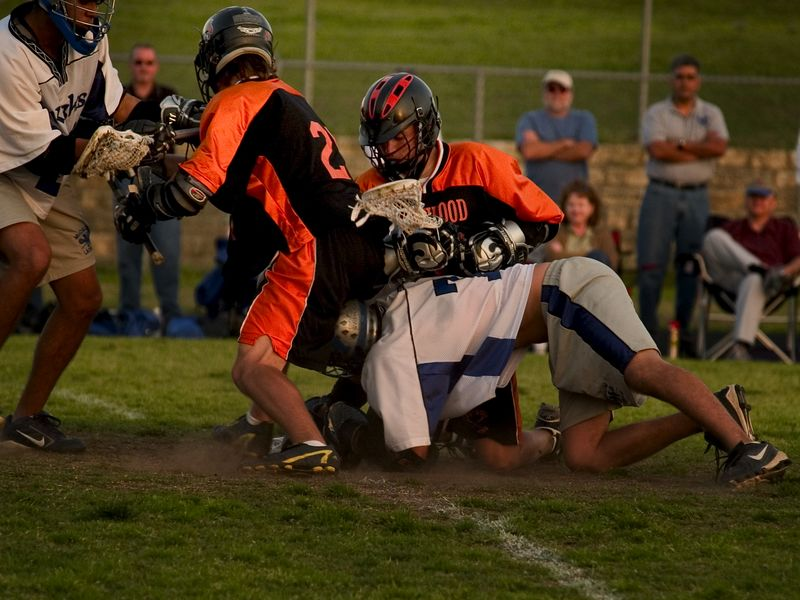 Midfielders Nate Ostrout and Sam Garrison fight for a ground ball after a face off.