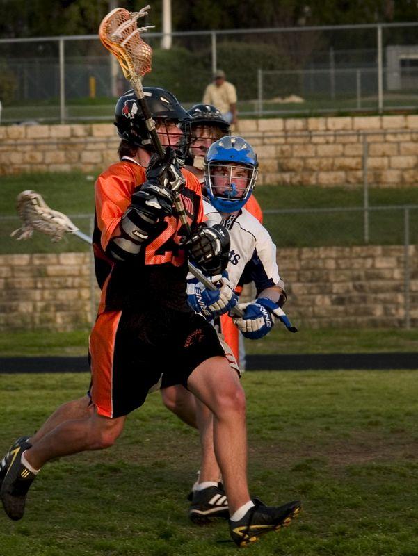 Sam Garrison (middie) dodges the defender.