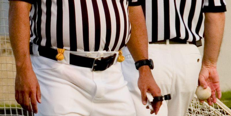Ref tools of the trade, whistle, ball and flags.