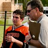 Gavin Rogus has a quick talk with his father Ed on the sidelines.