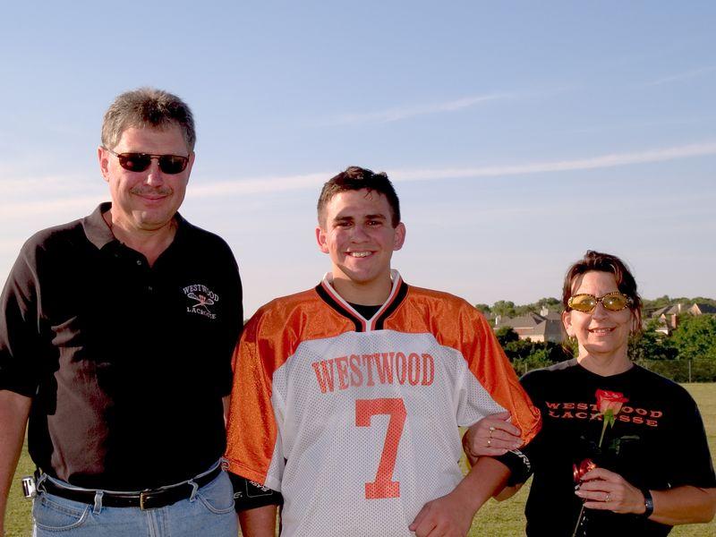 Gavin Rogus, Senior Defense, with parents Ed and Carol