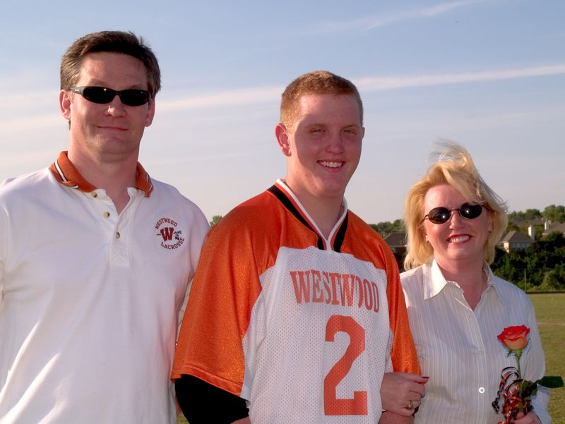Michael Becherer, Senior Defense, and team co-Captain, with parents Chris and Robin Hanna
