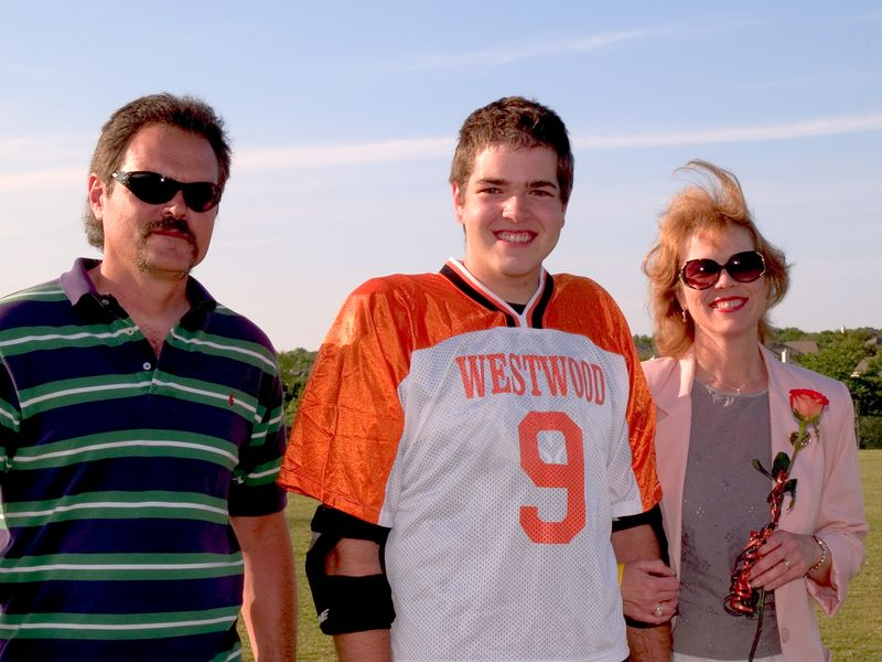 Ryan Osgood, Senior Defense, with parents Doug and Ginger