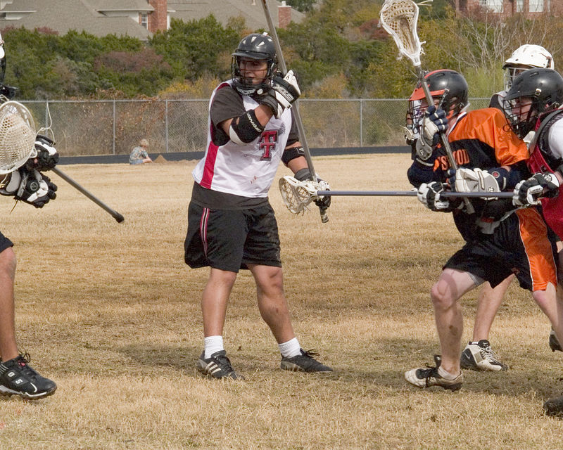Attackman George Lattimore fires and scores, while last year's defender Gavin Rogus watches it hit the net.