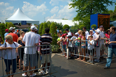 fans gather at the player entrance in hopes of meeting their favorites at the tennis tournament in Mason on Aug 16, 2009