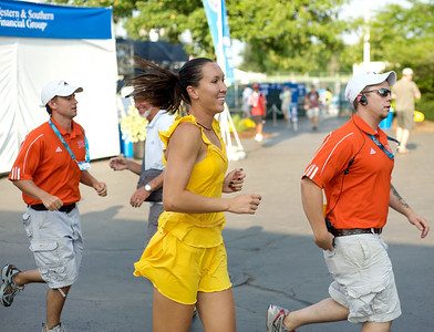 No. 5 ranked Jelena Jankovic seen running through the crowd after her defeat over no 1 ranked Dinara Safina at the 2009 WTA Tour Western & Southern Financial Group Women's Open on August 16.