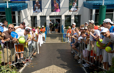 Fans gather near the player entrance in hopes of getting autographs at the tennis tournament in Mason on Aug 16, 2009