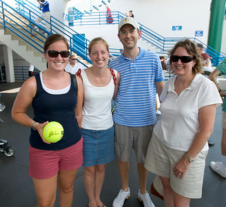 Kim Smith, Elizabeth and Robert Muyskens and Kathy Smith of Lexington show off their tennis ball signed by Huber and Black at the tennis tournament in Mason on Aug 16, 2009