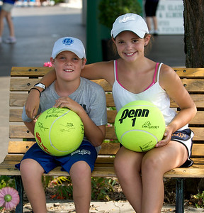 Jack and Kari Fitzpatrick have giant tennis balls that they've had autographed by players at the tennis tournament in Mason on Aug 16, 2009