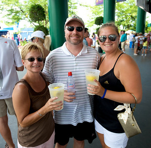Bev and Robert Christensen and Annika Olsson of Mason beat the heat at the tennis tournament in Mason on Aug 16, 2009