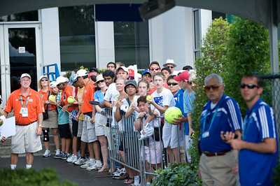 Fans look on in disappointment as Roger Federer arrives and chooses a different entrance.