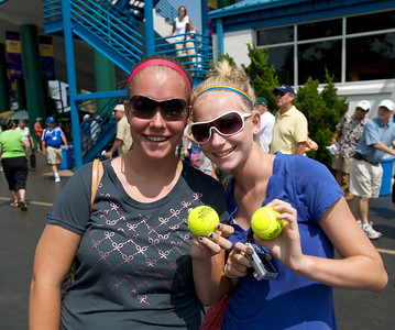 Shannon McEvoy and Rachel Sutton of Ft. Wayne, IN look for someone to autograph their tennis balls at the tennis tournament in Mason on Aug 16, 2009