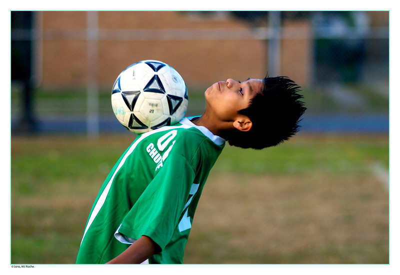 Seventh grader Adrian performs a chest catch in order to control the ball.