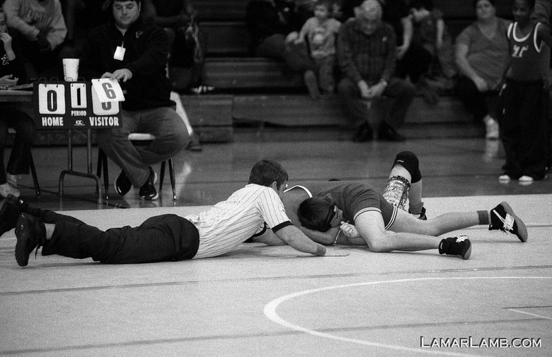 """J.R. Trippe Middle School wrestling team at East Dublin, GA. Dec 1, 2011; Photographed with a <a href=""""http://www4.ncsu.edu/unity/users/j/jnwall/html/NikonF4FAQVersion6.0.htm"""" target=""""_blank"""" >Nikon F4</a> / 80-200mm f/2.8 AF-D / Ilford HP5 pushed 3 stops to ISO 3200. Developed in XTOL."""
