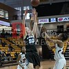 Olivia Meyers uses her height advanatge to reel in a rebound.