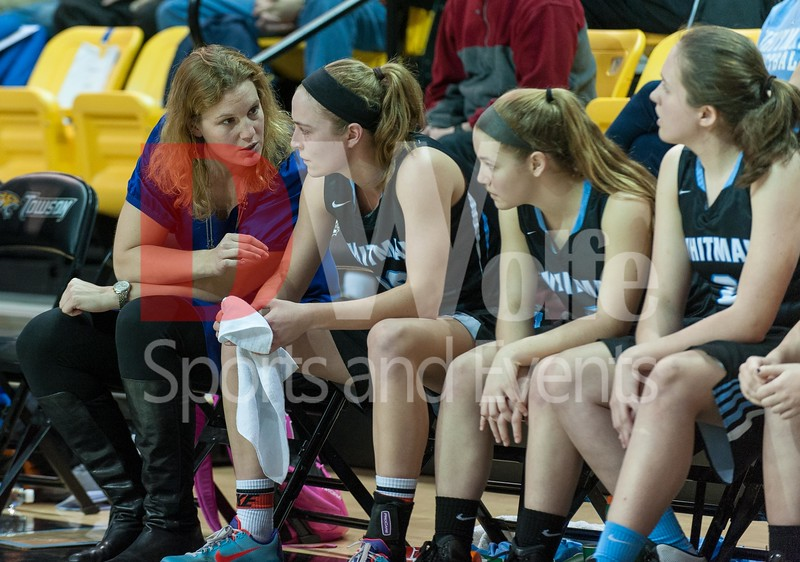 Abby Meyers and Whitman's assistant coach Terri Lakowski have a discusson on the as Abby gets a breather from the floor,