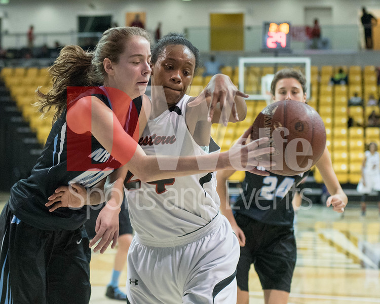 Undeterred by the physicality of Jadia Jackson's play for the ball, Olivia Meyers gets a pass off to Betsy Knox (not shown)  just outside the lane.