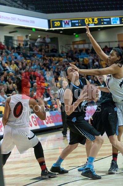 Betsy Knox takes a blow to the face from Western's Alayah Walker on her push to put two more points on the board.