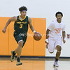 Seneca's Brandon Simpson shadowed by Rockville' Jeffrey Gomez as Brandon brings the ball up court.