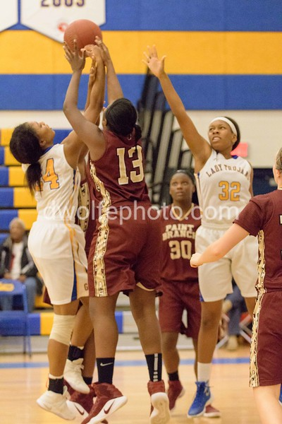 There is a battle in the lane for control of the ball between Paint Branch and Gaitehrsburg.  Leading the charge for Paint Branch is Alex Glove (13) who fouled out of the game soon after this play.