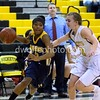Mariah Mcallister from Bethesda Chevy Chase High School drives the corner against Kate Schuck  of Richard Montgomery High School.