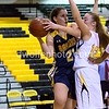 After pulling in a rebound, Caitlyn Clendenin of BCC muscles off Richard Montgomery's Melanie Osborne for a pass from under the rim.