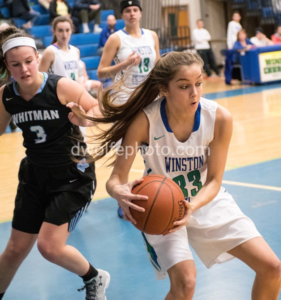 Winston Churchill's Kamryn Testa, a sophomore prevents Elizabeth Holden from getting to the ball on a rebound.