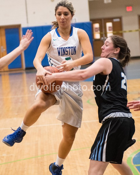 Alex Hacopian, a captain for Churchill's girls basketball team battles with Whitman's Sophia Tompkins, a senior for control of the ball.