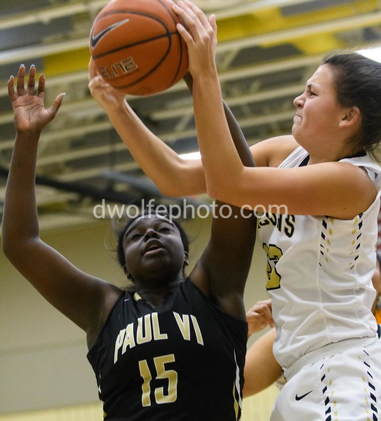 Meggie Burgess from OLGC steals a rebound from Ashley Owusu of St Paul VI.