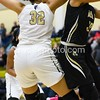 OLGC's Breonna Mayfield fouls Mikayla Vaughn when she knocks her in the head with elbow.