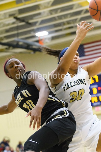 Jayla James of St Paul VI gives OLGC's Cara Judkins a not so subtle hip check, drawing a foul.
