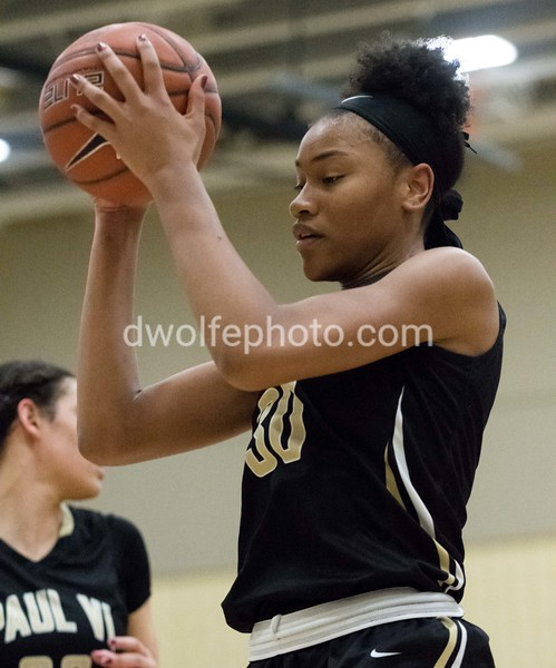 Mikayla Vaughn pulls in a rebound and gets called for a foul in the process.