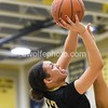 UNder pressure of OLGC players Amira Collins from StPaul VI puts up a jumper right under the rim.