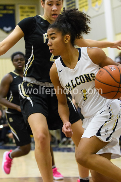 OLGC's Chloe Chapman takes the route of greatest resistance running th ebaseline guarded by St Paul VI's Amira Collins.