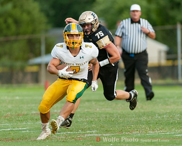 Pooleville's Junior defensive end Ryan Kasten chases down Seneca Valley's senior running back Adrian Feliz-Platt.  Seneca Valley won the game 42 to 20.