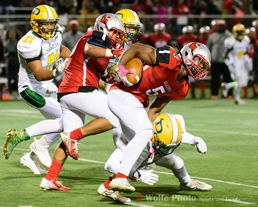 Blair captain and running back Eric Zokouri gtes hit low by a Damscus player.