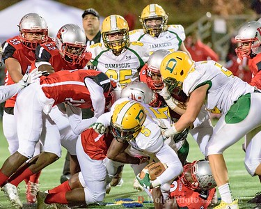 Damascus Elijah Atkins gets mobbed Blair Blazer players for a short gain in yardage.