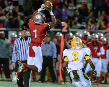 Blair high school wide receiver Cliff Carter goes to the air to reel in a Desmond Colby pass.