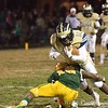Playing ironman football Markus Vinson wraps up Potomac's Juwan Watkins stopping his forward advance.