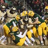 Potomac wide receiver Desoto McKenzie gets swarmed by the Damascus Hornets stopping his forward motion.