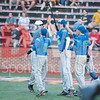 Erik Brodkowitz (13) is congratulated by his Churchill team mates on scoring a run.