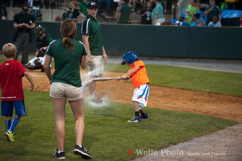 A between inning contest of which team of two can hit break all the water ballons in the bucket first.  The unidentified little guy in the orange t-shirt handled the bat like a seasoned pro.