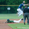 Josh Ingham (7) leaps in the air to avoid David Del Grande sliding into second base.