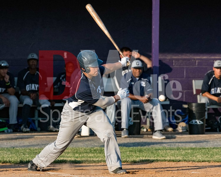 DC Grays Outfielder out fo Eastern Kentucky University cracks one off his bat.