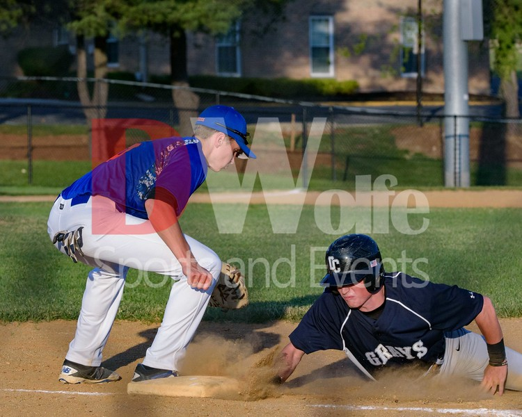 Infielder Andrew Valichka for the Rockville Express tags  Parker Farley as he tags back on a failed second base steal attempt.
