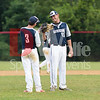 Gaithersburg Giants pitcher David Hutchison of Jessup, Md gets a couple of word of encouragement before throwing his first pitch of the evening from  Pat Hisle from Bethesda and a senior at the University of Md.
